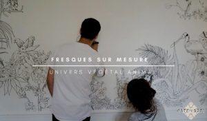 image représentant deux artistes travaillant sur un mur