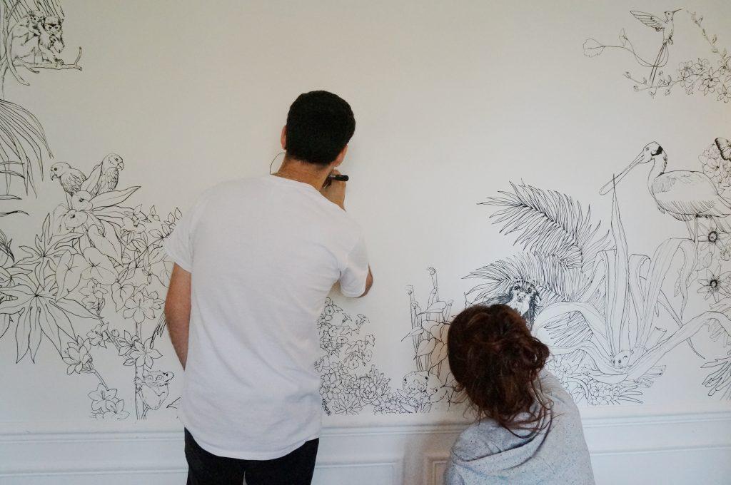 image illustrant les artistes en train de faire une fresque murale